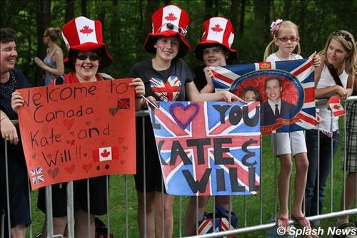 Crowds of royal watchers, some wearing fascinators, line up hours before the arrival of the Duke and Duchess of Cambridge outside Rideau Hall in Ottawa
