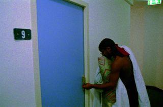 Naked man hallway